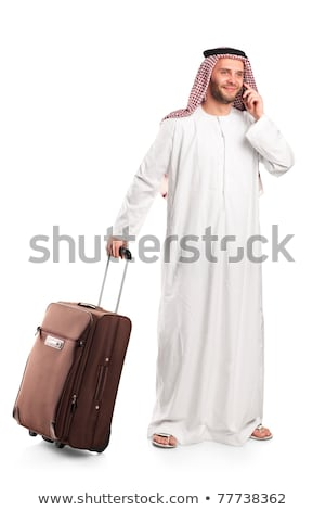 Young smiling arab with a suitcase isolated on white stock photo © vlad_star