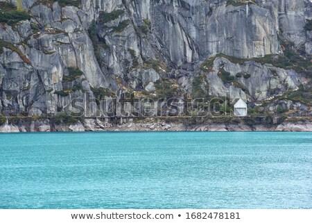 Primeiro luz solar lago reservatório alpes Suíça Foto stock © mdfiles