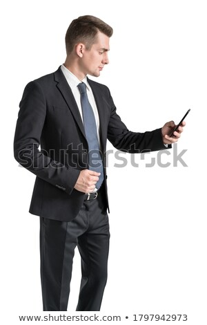 businessman looking down using a gadget in his hands stock photo © dgilder