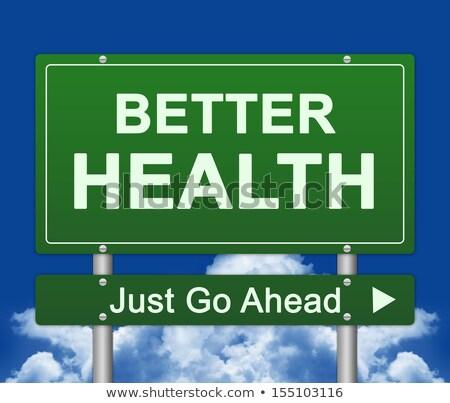 Health Life on Green Highway Signpost. Stock photo © tashatuvango