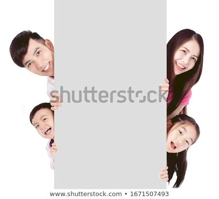 Gyerekek mögött fehér tábla aranyos kicsi boldog Stock fotó © trendsetterimages