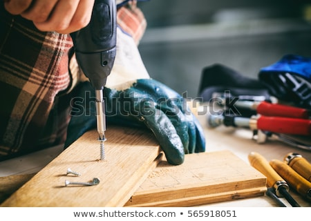 Drill with timber, screwdrivers and screws Stock photo © juniart