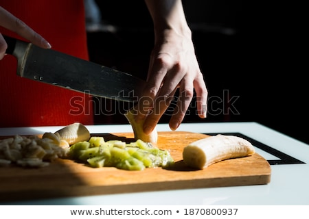 female chopping juicy orange on the kitchen stock photo © fantazista