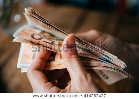 businessman counts euro money stock photo © smuki