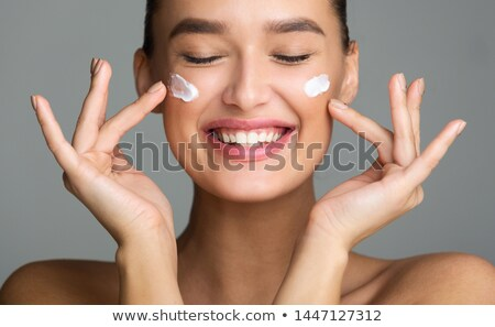 Woman Face in Toothy Laugh with Eyes Closed Stock photo © ozgur