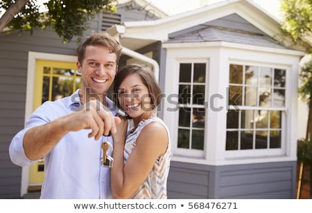 excited woman outside new home holding keys stock photo © highwaystarz