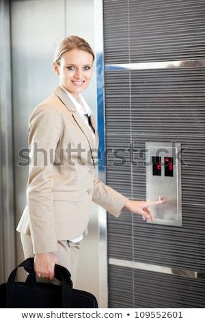 幸せ 女性実業家 プッシング エレベーター ボタン 肖像 ストックフォト © deandrobot