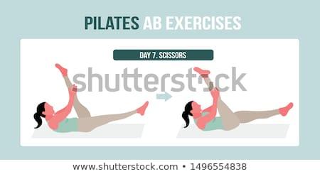 Pilates mujer tijeras ejercicio entrenamiento gimnasio Foto stock © lunamarina