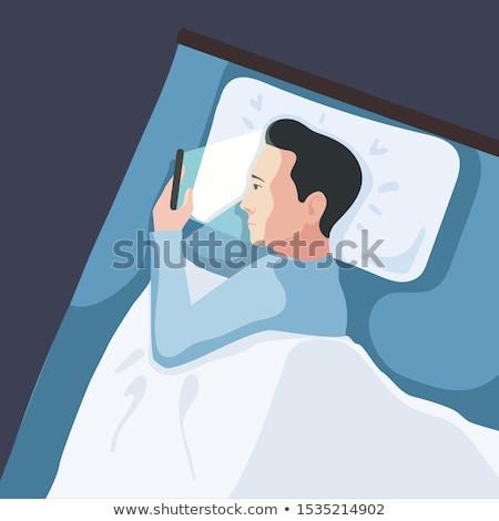 férfi · okostelefon · ágy · portré · boldog · otthon - stock fotó © deandrobot