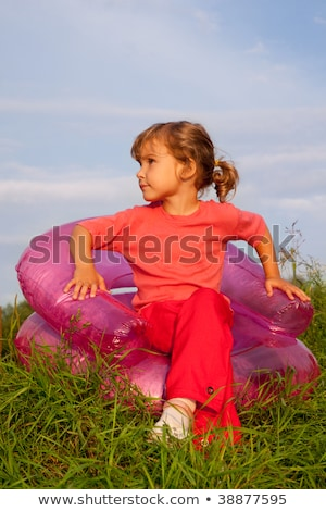 girl looking at the sky in inflatable armchair stock photo © paha_l