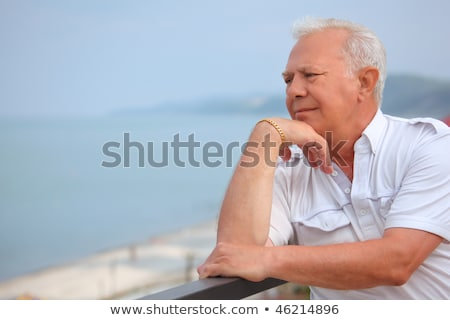 sad senior on veranda near seacoast, looking afar, lean elbows a Stock photo © Paha_L