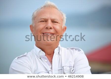 smiling senior near seacoast against mountain Stock photo © Paha_L