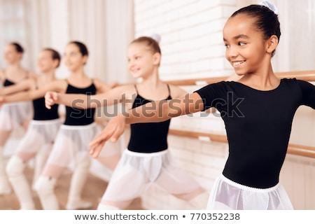 Ballerina standing in ballet class Stock photo © deandrobot