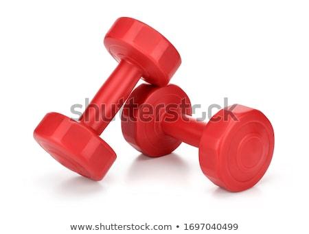 Piros súlyzó kéz tart közelkép lövés Stock fotó © devon