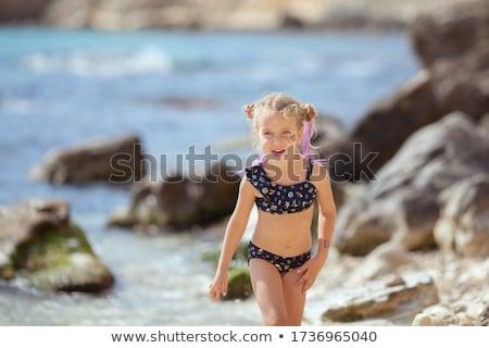 Girl in swimsuit on the stone Stock photo © bezikus