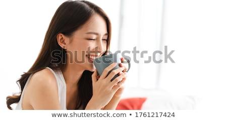 Nina té mujer hermosa taza de té platillo Foto stock © dnsphotography