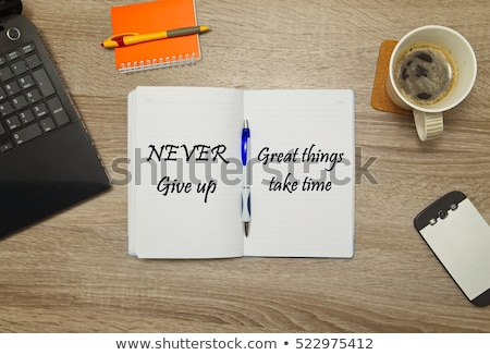 never give up text on notepad stock photo © fuzzbones0