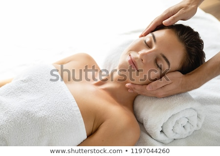 beautiful young woman during face massage session stock photo © elnur