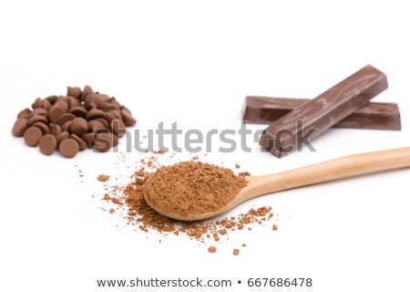 Wooden spoon full of  chocolate chips Stock photo © StephanieFrey