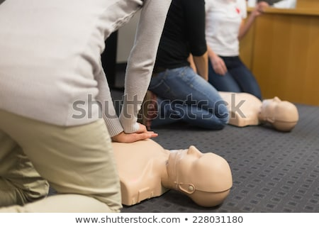 Practicing CPR chest compressioon on a dummy Stock photo © vladacanon