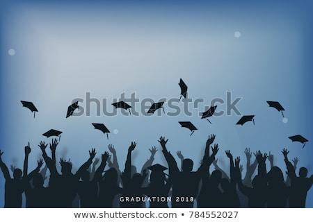 Graduated student throwing cap Stock photo © bluering