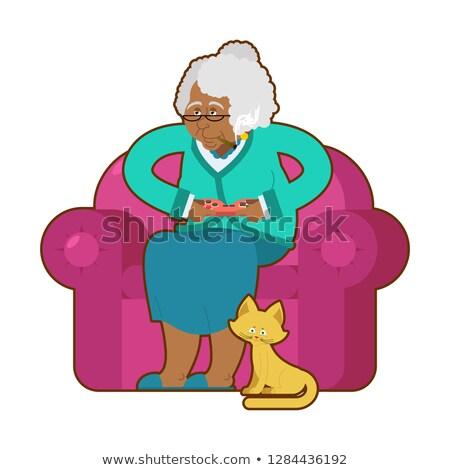 Grand-mère joystick noir granny jouer Photo stock © popaukropa