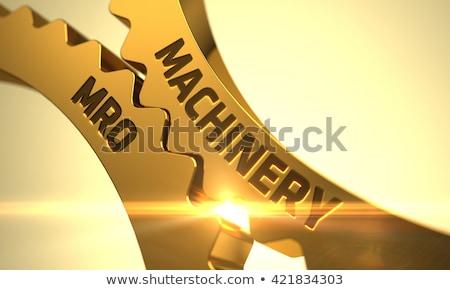 Equipamento dourado metálico roda dentada engrenagens mecanismo Foto stock © tashatuvango