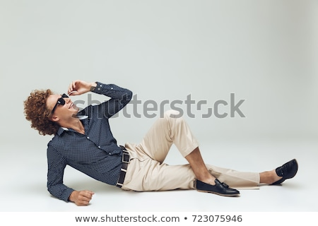 Retro man dressed in shirt lies on floor and posing Stock photo © deandrobot