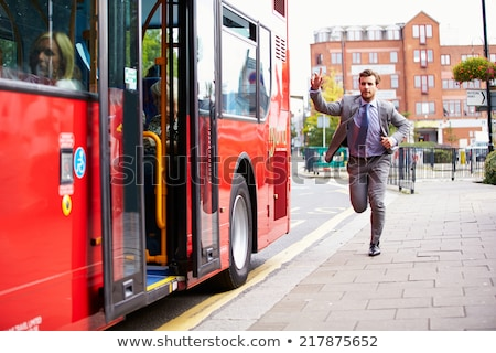 Businessman running for the bus Stock photo © RTimages