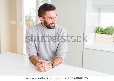 laughing young casual man looks to side stock photo © feedough