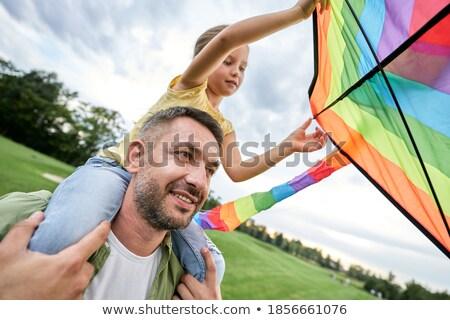 ストックフォト: 家族 · 飛行 · カラフル · カイト · シルエット
