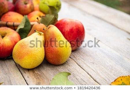 Maçãs peras mesa de madeira monte orgânico tabela Foto stock © mpessaris