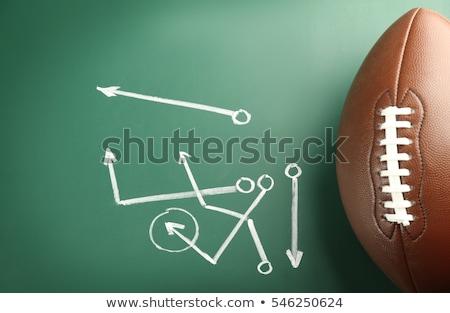 american football with game plan on green chalkboard stock photo © tab62