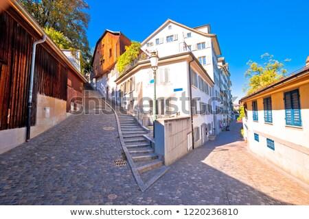 Old cobbled street scene of Zurich Stock photo © xbrchx