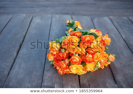 Bridal bouquet of roses on a  wooden planks Stock photo © ruslanshramko