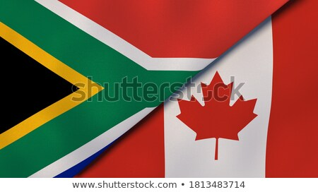 Two waving flags of Canada and south africa Stock photo © MikhailMishchenko
