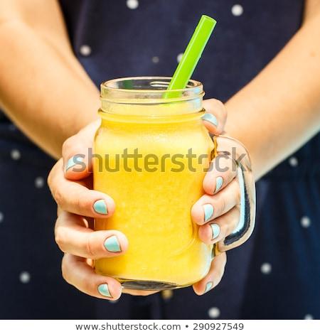 Jonge vrouw smoothie mango zwembad vruchten Stockfoto © galitskaya