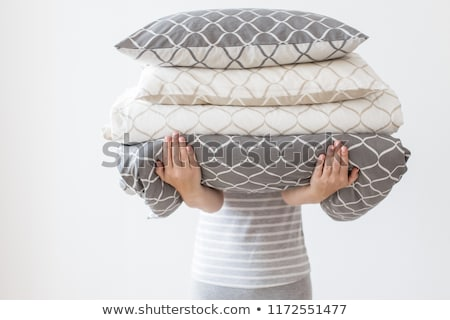 Hands of woman holding modern beige and white bed linen pile, wh Stock photo © dashapetrenko