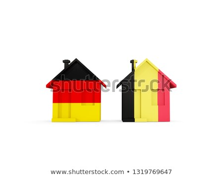 Two houses with flags of Germany and belgium Stock photo © MikhailMishchenko