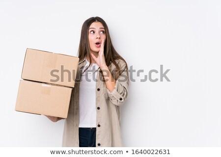smiling women carrying the cardboard box stock photo © kzenon