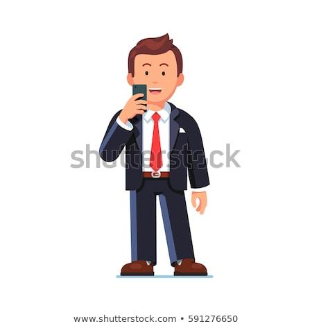 фото улыбаясь служащий костюм мобильного телефона Сток-фото © deandrobot
