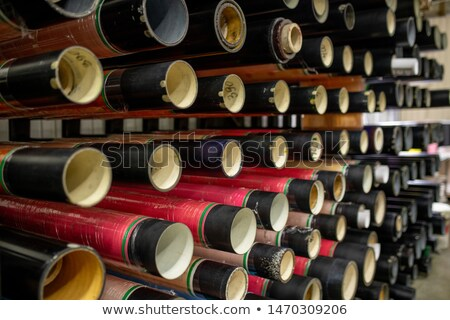 Several rows of pipe-like bobbins prepared for new batch of polyethylene film Stock photo © pressmaster