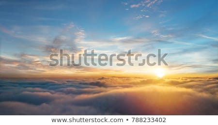 airplane view of clouds ocean and bright sun stock photo © vapi