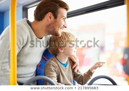 father and son in a public transport Stock photo © galitskaya