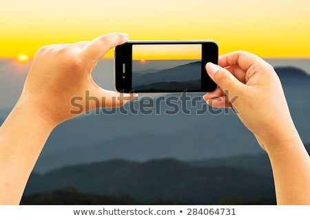 Stock photo: Woman taking in early morning mountain views
