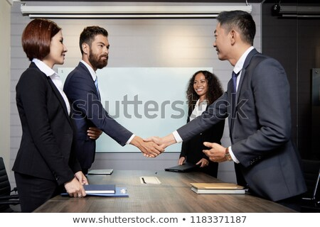Side view of diverse team of executives having business meeting together in modern office. The Afric Stock photo © wavebreak_media