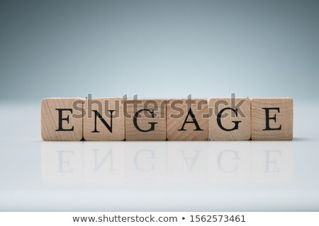 Row Of Wooden Blocks Showing Engage Text Over Desk Stock photo © AndreyPopov