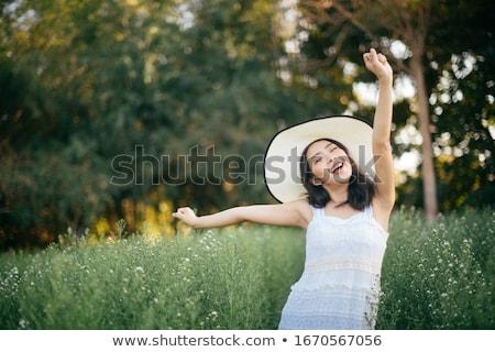 Retrato bela mulher flores da primavera mão sorrir sensual Foto stock © artjazz