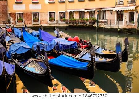Italian gondola parking on the water in Venice, Italia. Stock photo © artjazz