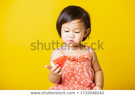 Adorable little girl of Asian ethnicity wearing red t-shirt and handband Stock photo © pressmaster
